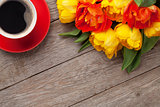 Colorful tulips and coffee cup