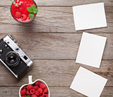 Vintage camera, photos and raspberry smoothie