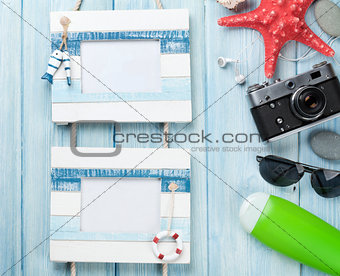Travel and vacation photo frames with items over wood