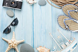 Travel and vacation items on wooden table