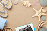 Travel and vacation background with items over sand