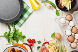 Pasta cooking ingredients and utensils on table