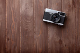 Vintage film camera on wooden table