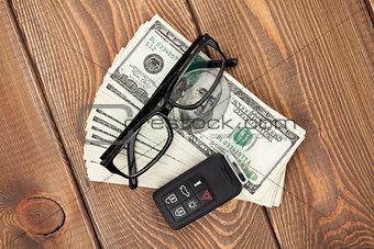 Money cash, glasses and car remote key