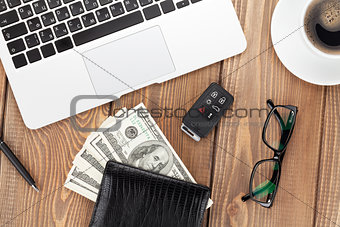 Office table with pc, coffee cup, glasses and money cash