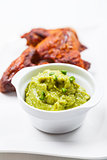 Grilled chicken wings with guacamole