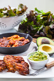 Grilled chicken legs and wings with guacamole