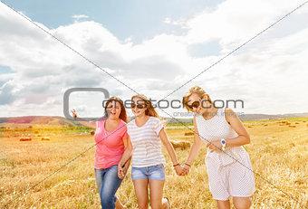 Three best friends having fun outdoors