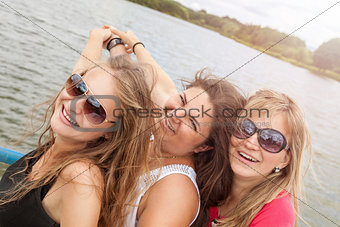 Group of friends having fun outdoors on a lake