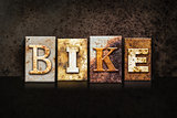 Bike Letterpress Concept on Dark Background