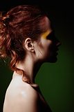 Closeup portrait of lovely red-haired woman. Profile view