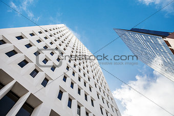 Fragment of a glass skyscraper merged with blue sky. skylines in down town