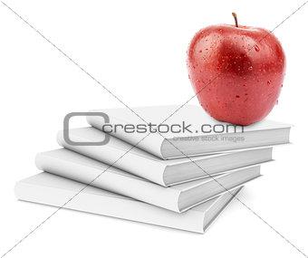 Fresh apple on stack of white books