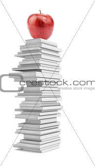 Fresh apple on pile of white books