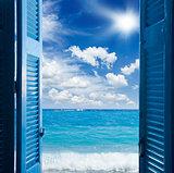 room with open door  to seascape