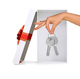 Gift box with hand and keys on white