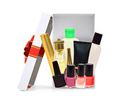 Open gift box with cosmetics on white