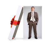 Businessman in gift box on white