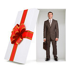 Businessman with suitcase in gift box on white
