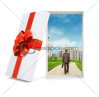 Cityscape with walking businessman in gift box