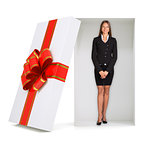 Businesswoman looking at camera in gift box