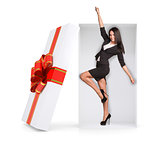 Businesswoman in winner posture inside gift box