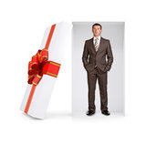Serious businessman in gift box on white