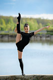 Rhythmic gymnast doing vertical leg-split