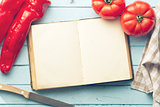 blank cookbook and vegetable