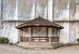 gazebo against building wall