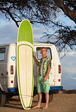 Person Posing with Surfboard