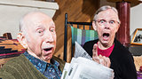 Angry Old Couple with Newspaper