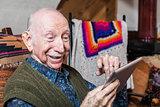 Smiling Older Gentleman with Tablet