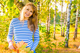 happy expectant mother walks in autumn park