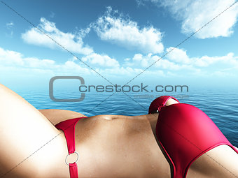 Close up of a 3D female figure in a bikini sunbathing