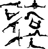 Silhouettes of females in yoga poses