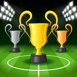 Soccer Background with Bright Spot Lights and Three Award Trophy