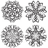 set of symmetrical patterns. Snowflakes or flowers