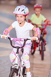 Happy children on bicycles