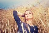 Cute girl on wheat field
