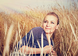 Beautiful woman in wheat field