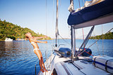 Joyful woman on sailboat