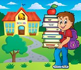 Boy holding books theme image 2
