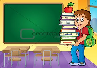 Boy holding books theme image 4