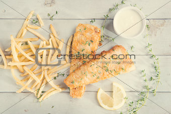 Top view fish and chips in vintage style