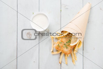 Top view fish and chips wrapped in paper cone