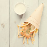 Top view fish and chips in paper cone, vintage style
