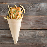 Top view fish and chips in paper cone
