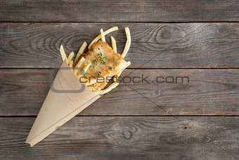 Top view fish and chips wrapped in cone