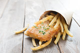 Fish and chips wrapped in paper cone